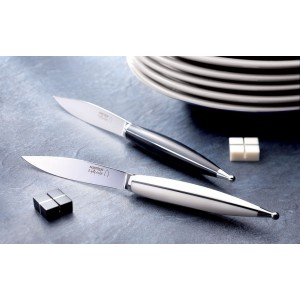 Steak knives, black dica and white corian handles